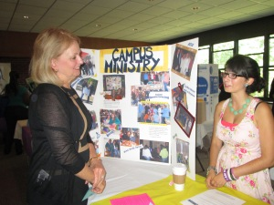 President Helen Streubert chats with Marissa Gioffre, junior global studies major, during the EAGLES fair.